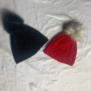Two black and red matching hats.